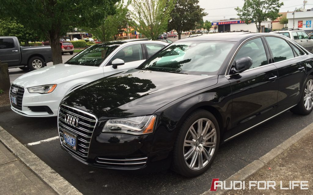 Contrasting Audis: Black Audi A8 and White Audi A3