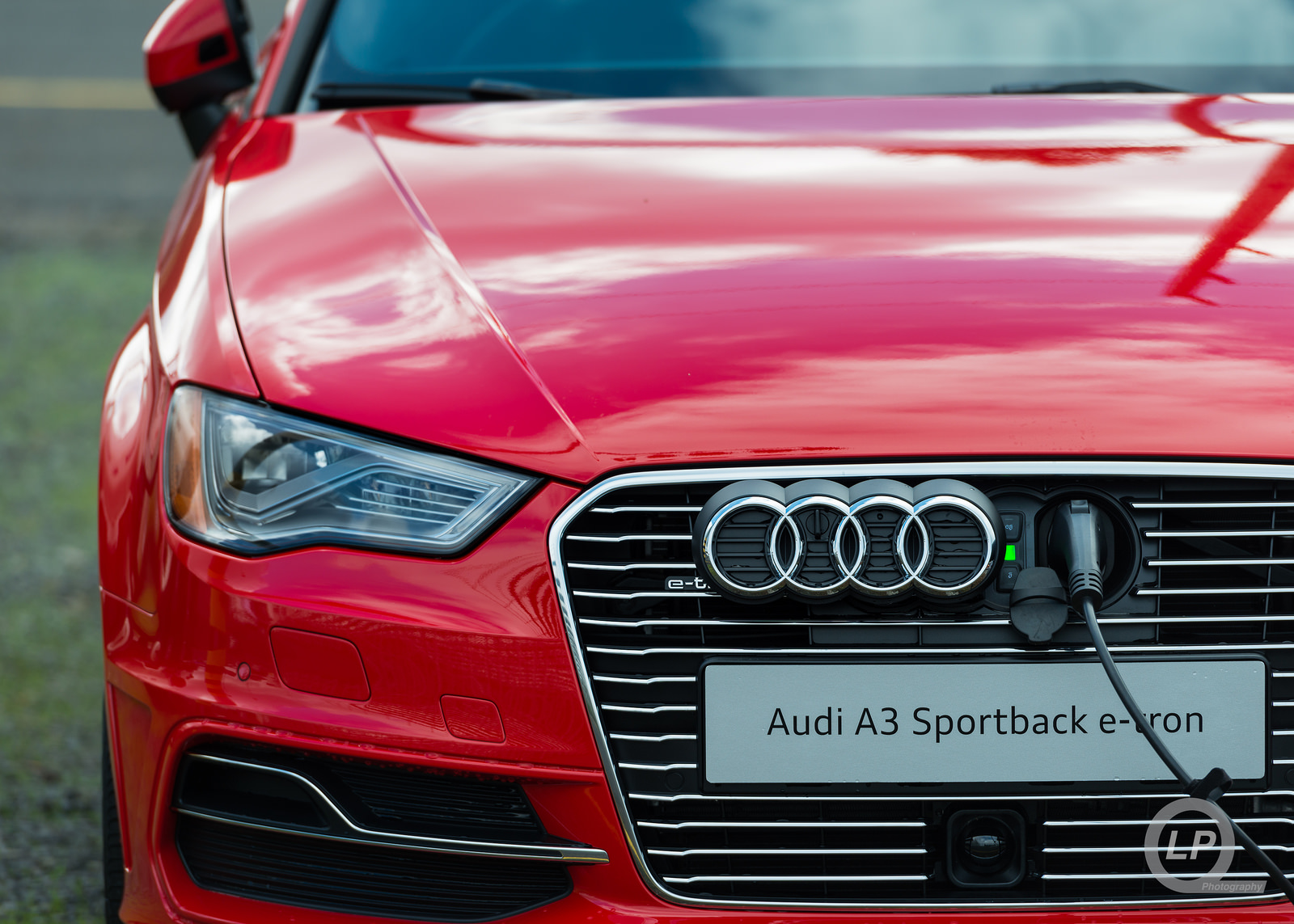 Red Audi A3 Sportback e-tron Charging Up at Quattrofest