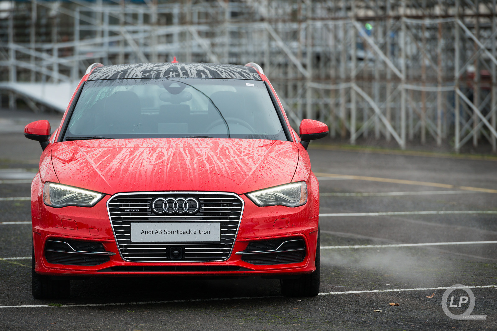 Red Audi A3 Sportback e-tron with LED headlights