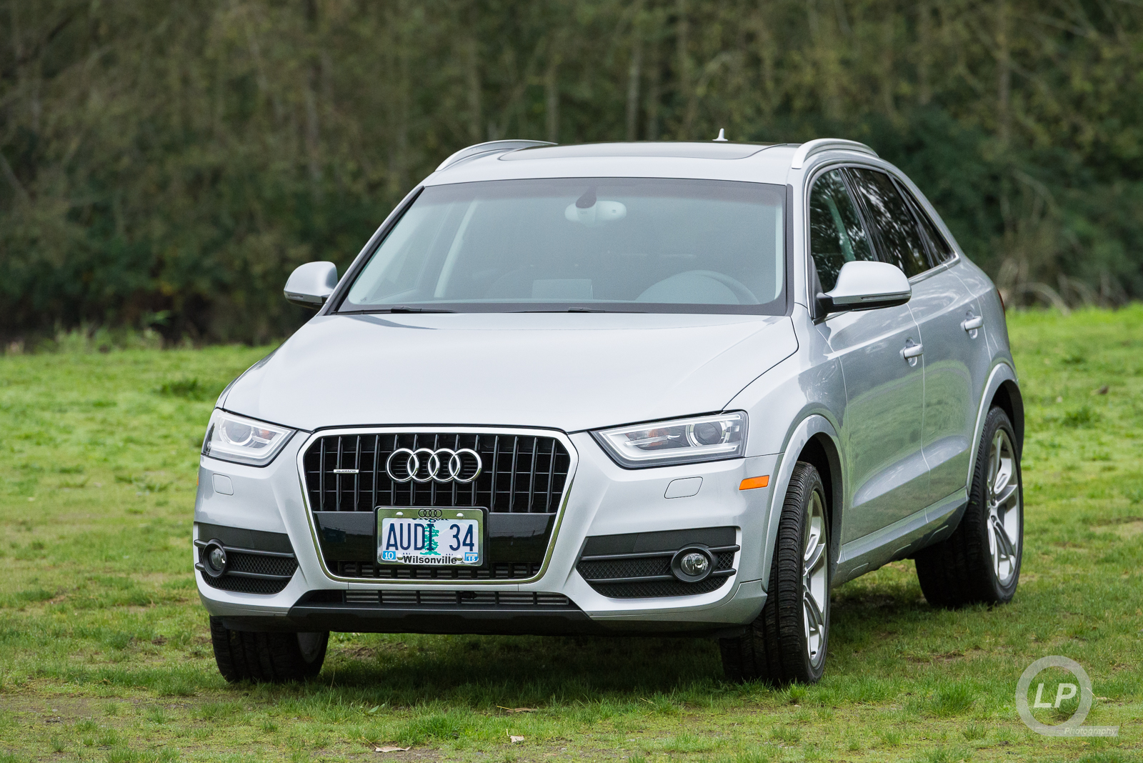 Audi Q3 parked in the grass at PIR