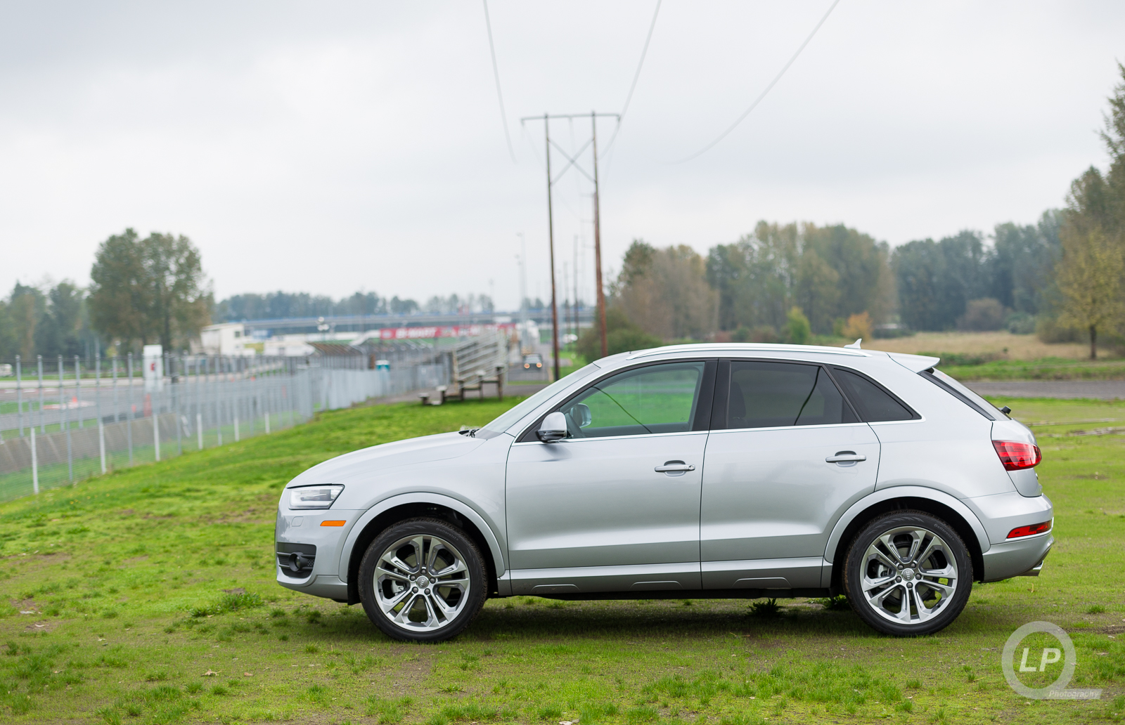 Audi Q3 parked next to the track at PIR